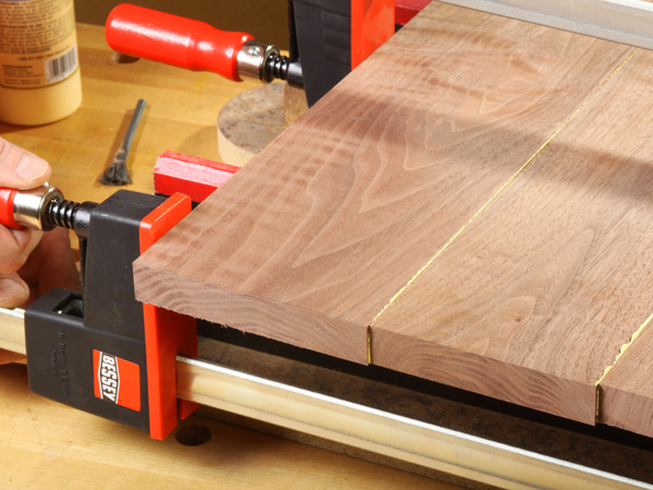 Clamping a wood panel during glue-up