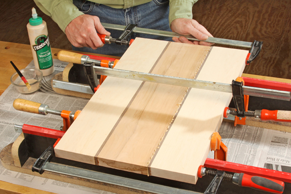 Applying Titebond III glue and clamping cutting board sections together