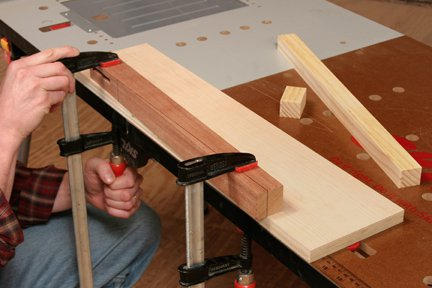 Clamping uncut leg to tapering jig