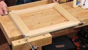 Using a frame clamp kit to fit miter joints