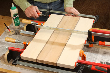 Clamping and gluing scrap pieces into cutting board shape