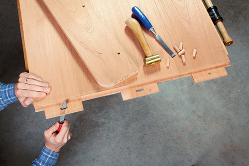 Filing holes in storage box lid tenons for wood movement