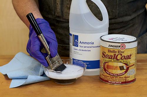 Cleaning finishing brushes with sudsy ammonia