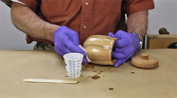 Wiping epoxy finish onto a turned jar project