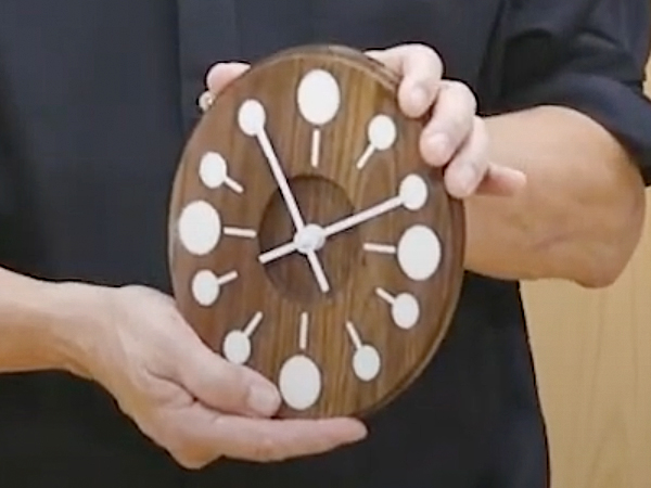 wood modern clock with white circles for numbers