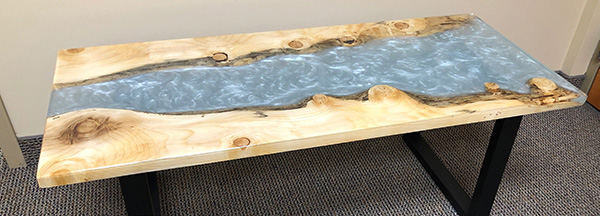 Finished and cured epoxy river table