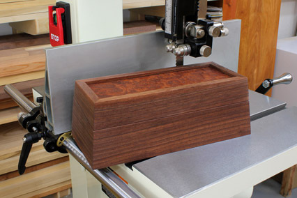 Continuous grain box with tapered sides