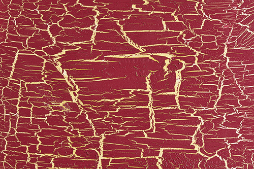 Red finish that has been intentionally cracked and aged