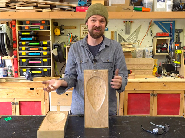Michael Alm displays a carved wood wall sconce