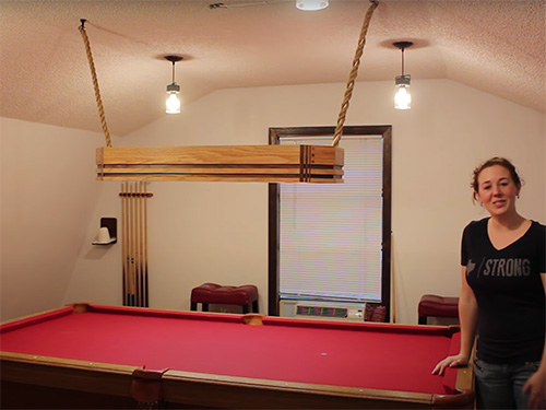 April Wilkerson and her oak and walnut pool table light