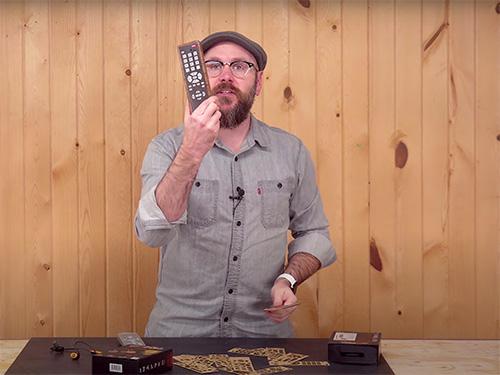 David Picciuto showing a wood veneered television remote