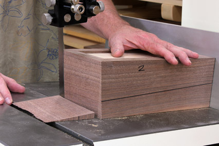Making tapered cuts on continuous grain box
