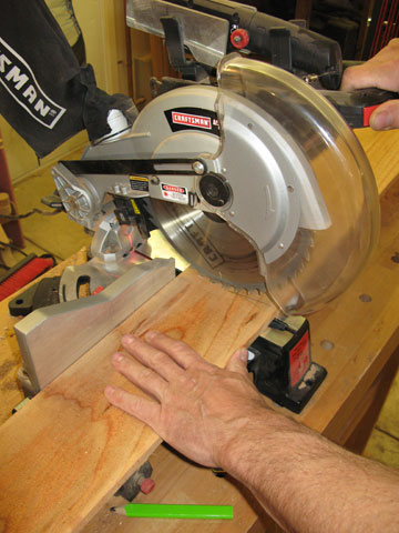 Using miter saw to cut cedar fencing to size