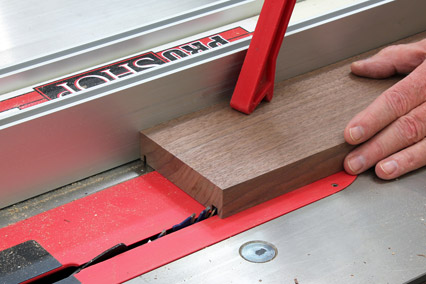 Using a table saw and dado blade to cut grooves for top and bottom of box