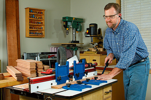 Using a table saw to cut grooves in slats for outdoor storage box