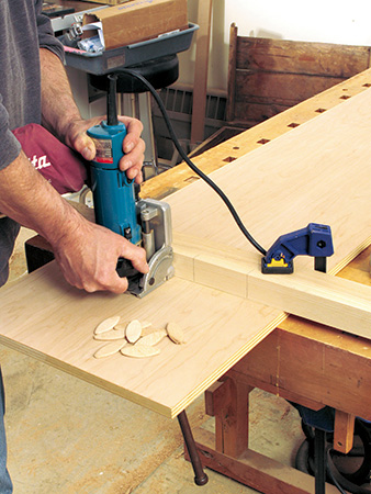 Cutting slots for adding biscuits to cabinet joinery