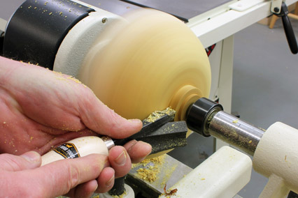 Cutting natural edge bowl tenon for mounting on the lathe