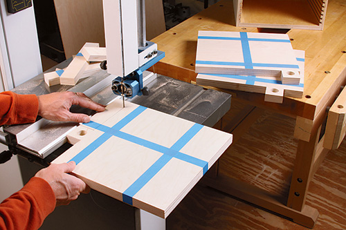 Using band saw to cut out saw blade storage trays