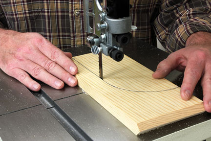 Using band saw to cut a panel guide