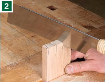 Cutting out pins with a dovetail saw