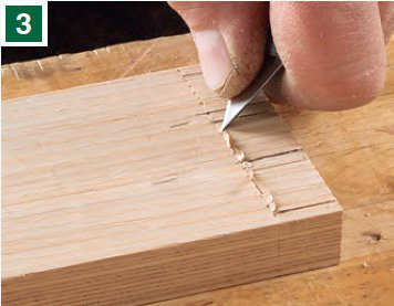 Marking dovetail waste with knife