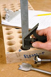 Measuring drill press holes