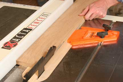 Cutting scrap strip for spline with featherboard