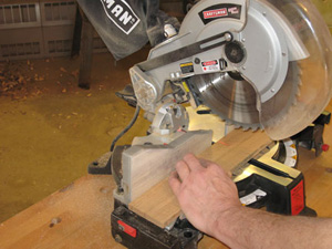 Using miter saw to cut white oak pieces for napkin holder
