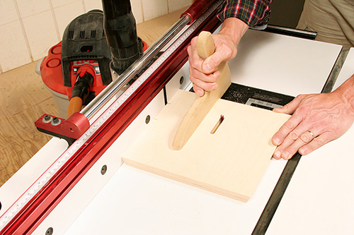 Routing hold-down bolt slot in tenoning jig