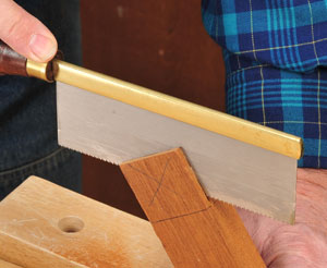 Finishing tenon cuts with a fine-toothed hand saw
