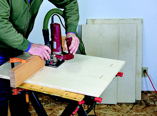 Cutting slots in tool storage cabinet panels