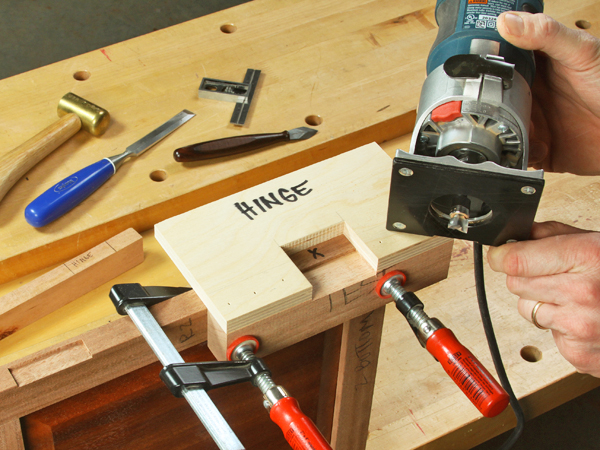 Routing a hinge location with a compact router