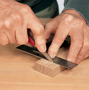 Marking joinery layout lines using a marking knife