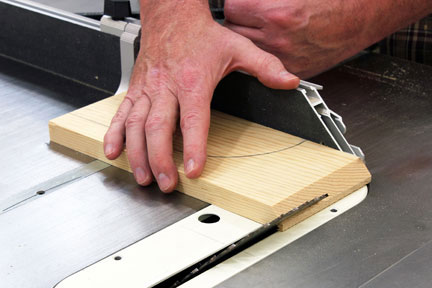 Cutting a pivot guide on a table saw