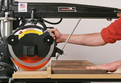 Making cut with a radial arm saw