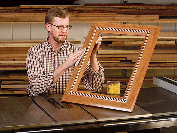 Polishing a picture frame with a dentil inlay