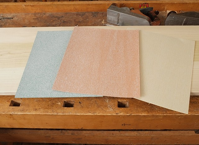 A selection of different brands and grits of sandpaper