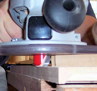 Router with dish-carving bit used to smooth ends of edge banding