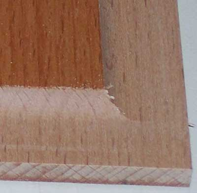 Concave edging for door panel cut with a dish cutting router bit