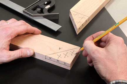 Using pencil to mark waste for cutting half-lap joint