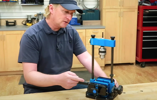 man looking at Rockler portable drill guide
