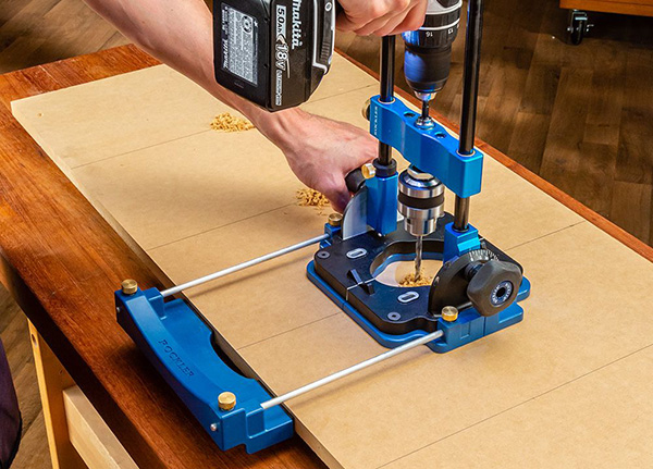 drilling a row of holes with Rockler portable drill guide
