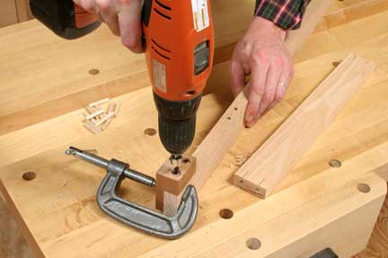 Using shop-made doweling jig to install dowel joints