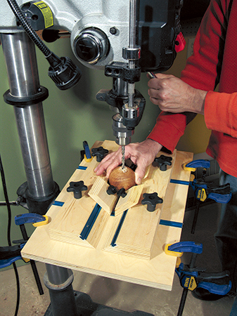 Drilling hole in a ball using a drill press and jig