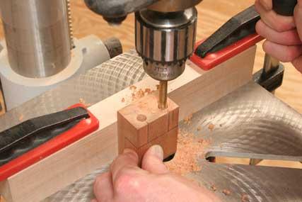 Drilling holes for bushings in dowel jig