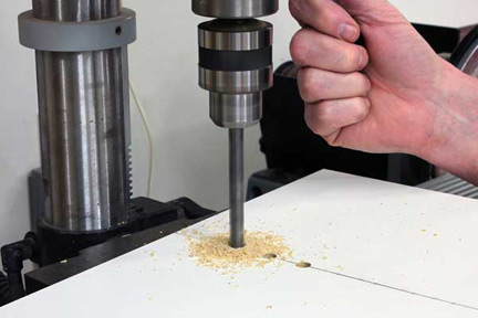 Drilling holes in circle cutting jig to set circle diameter