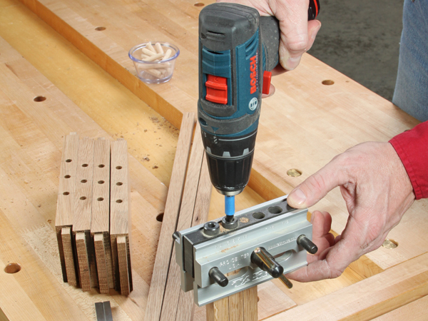 Cutting dowel holes with a clamp-on doweling jig