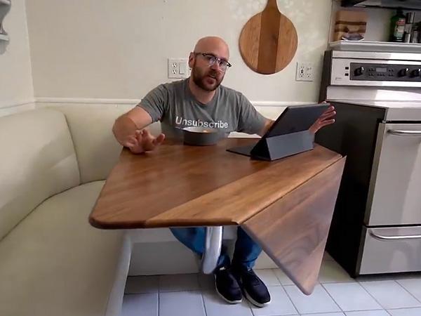 David Picciuto sitting at his drop leaf table