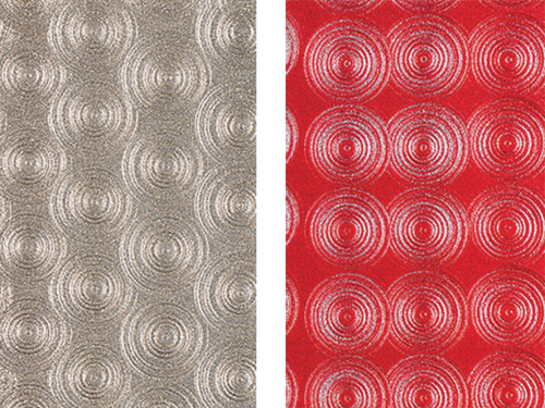Silver and red variations of an engine turned finish