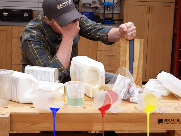 man with epoxy mess in workshop